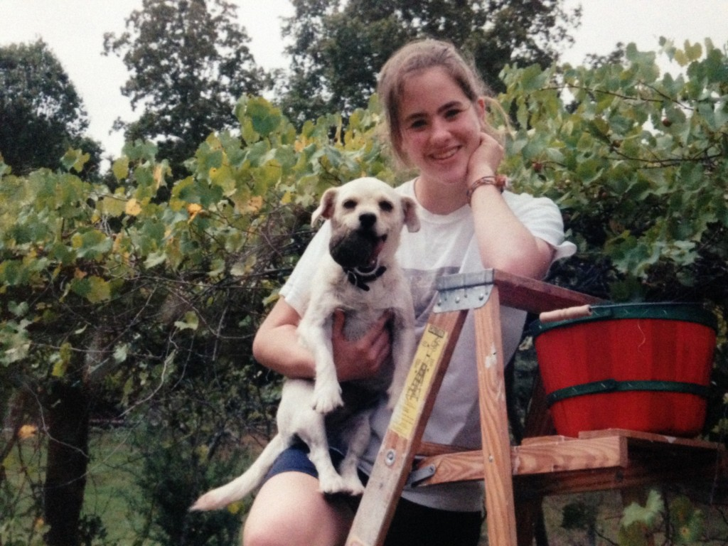 Cassidy and our dog, Vanilla, picking muscadines in our backyard.